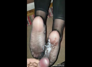 Sloppy jism flow on mature feet in nylon