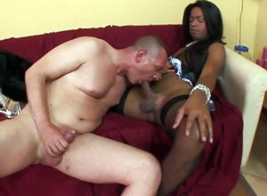 Huge-chested dark-hued she-male in..