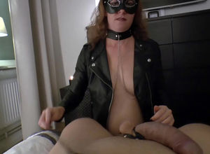 Mature domme in the mask gargling her..