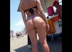 Sugary donks in g-string on a beach.